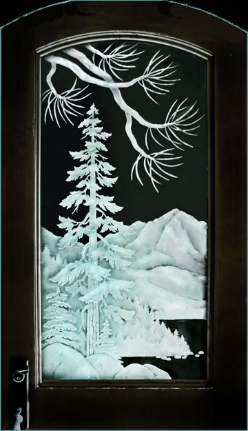 etched glass mountain scene with pine trees and lake