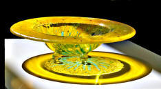 fused glass bowl, yellow sunburst with greens